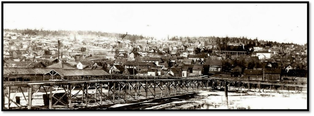 Wachsmuth lumber mill on the left and Bayfield Transfer trestle in the foreground