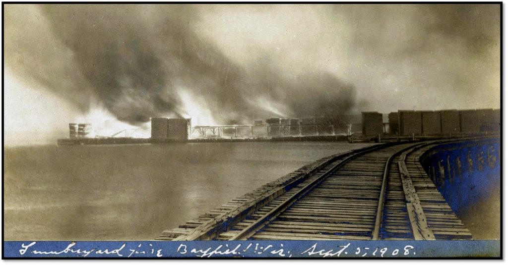 East Dock Lumber Piles and Tramway Ablaze Bayfield Transfer Railroad Trestle BHA 1983.32.39