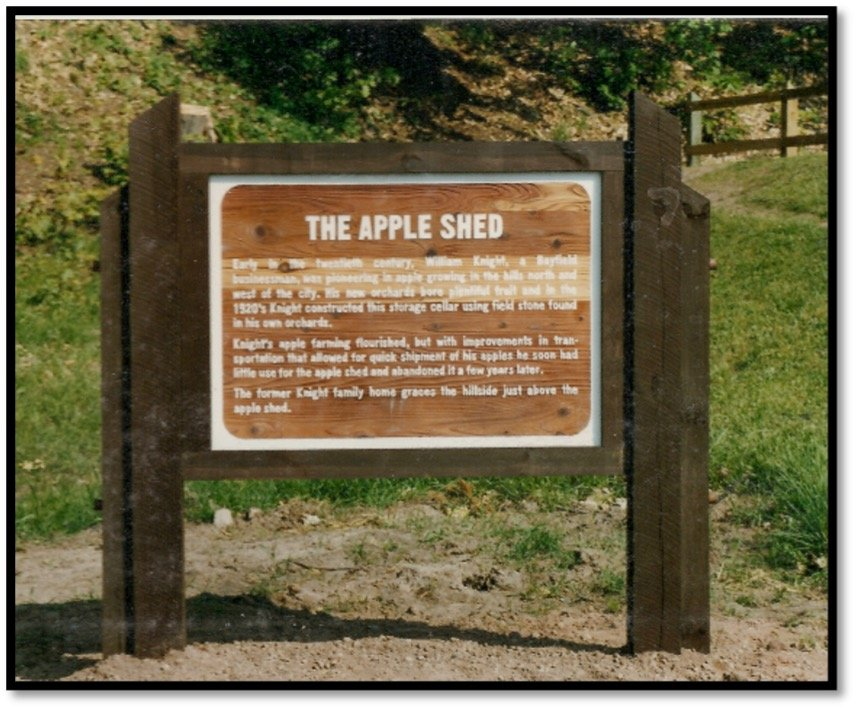 The interpretive sign posted outside the Bayfield Apple Shed on Washington Ave